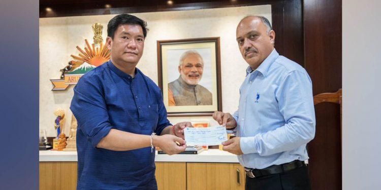 Arunachal CM Pema Khandu handing over the cheque of Rs 30 lakh. Image credit; Twitter