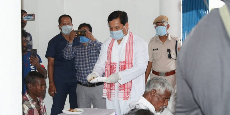 Assam CM Sarbananda Sonowal serving snacks on the occasion of Rongali Bihu on Tuesday in Dibrugarh. Image: Northeast Now