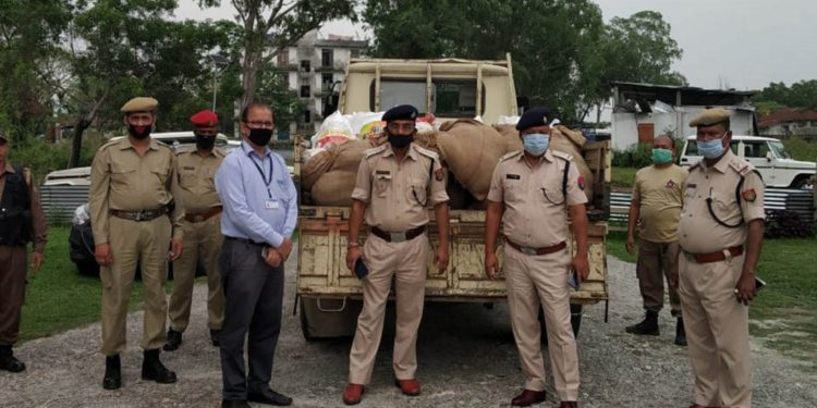 NTPC officials with Kokrajhar police officials. Image: Northeast Now