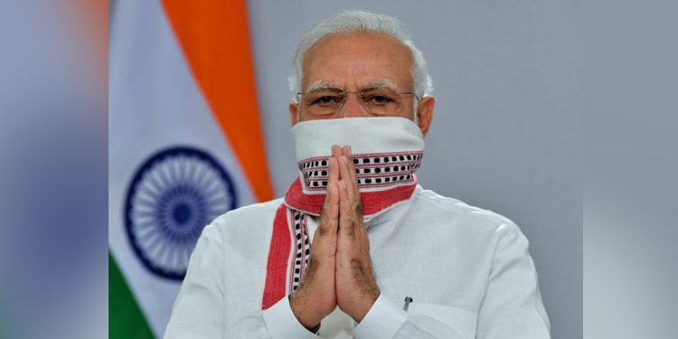 PM Narendra Modi with traditional Manipuri scarf Lengyan as mask. Image credit: PIB