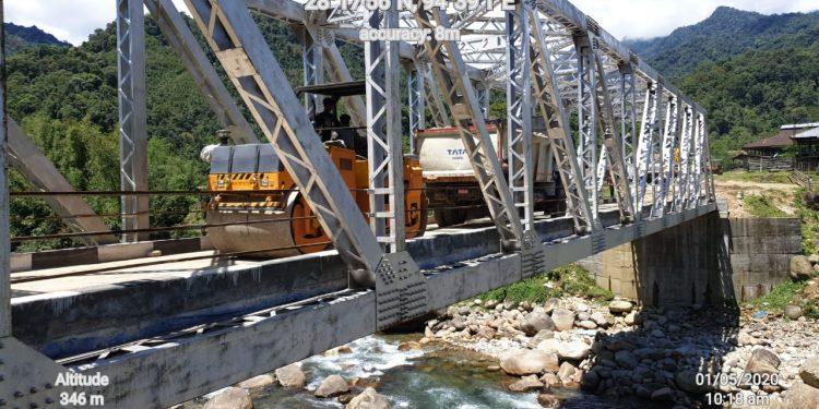 50-meter-long build-up girder (BUG) bridge over Siru River.