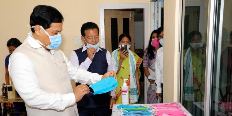 Assam Chief Minister Sarbananda Sonowal appreciating masks prepared by Asomi Mask Preparation Centre'