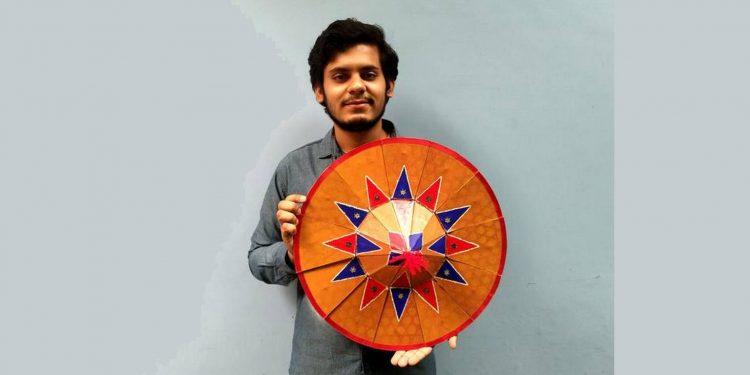 Rupankar Bhattacharjee with his folding Assamese japi. Image credit: The Hindu