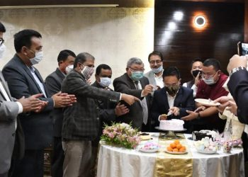 Sikkim CM Prem Singh Tamang cutting the one year anniversary cake in Gangtok. Image: Northeast Now
