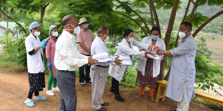Manipur health minister distributing PPE kits, N-95 masks to health workers in a quarantine centre. Image: Northeast Now