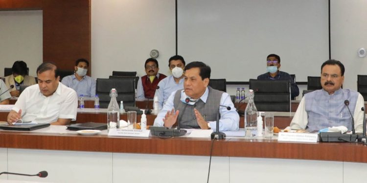 Assam CM Sarbananda Sonowal addressing a meeting in Guwahati on Wednesday