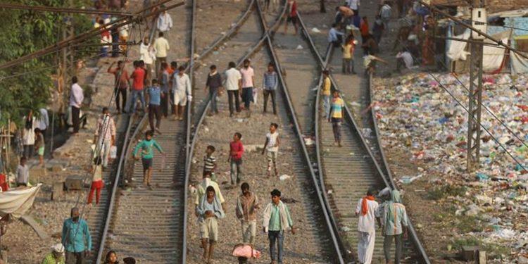 Migrant workers walking home along the railway tracks. Image credit: Al Jazeera