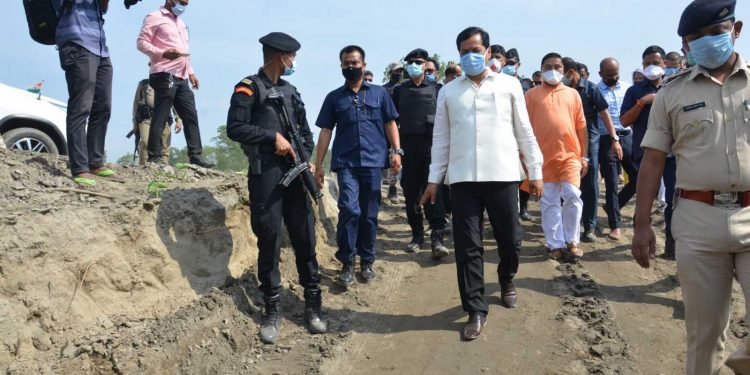 Assam CM Sarbananda Sonowal taking stock of construction of road cum embankment over Puthimari River at Athgaon in Kamrup district