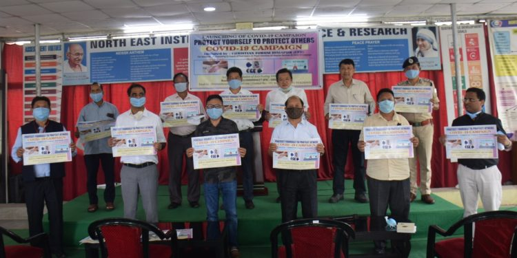 The members of the Christian Forum Dimapur with government officials displaying the car stickers and face masks during the launch of Covid-19 campaign at Dimapur Bishop's house on Friday.