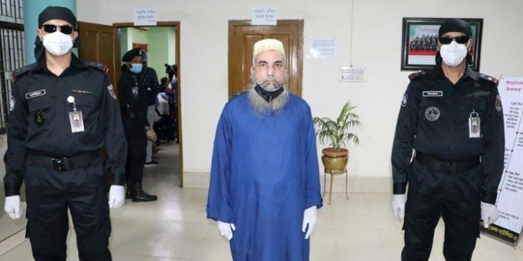 Kamal Uddin (C), the alleged mastermind of an international human trafficking gang.