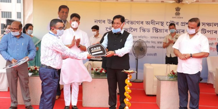 Assam CM Sarbananda Sonowal ceremonially handing over keys of skid-steer loaders and tippers to the municipalities of the state.