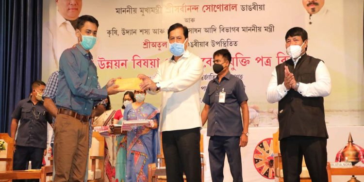 Assam CM Sarbananda Sonowal presenting appointment letters to 111 ADOs