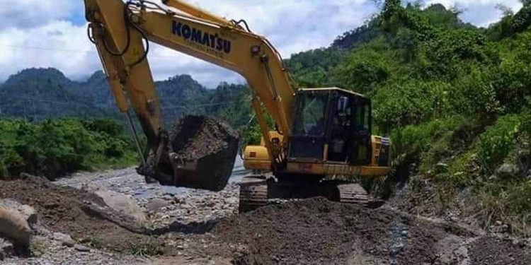 An excavator pressed to action at an irrigation channel in Bhutan