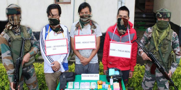 Assam Rifles team with the apprehended drugs peddlers. Image: Northeast Now