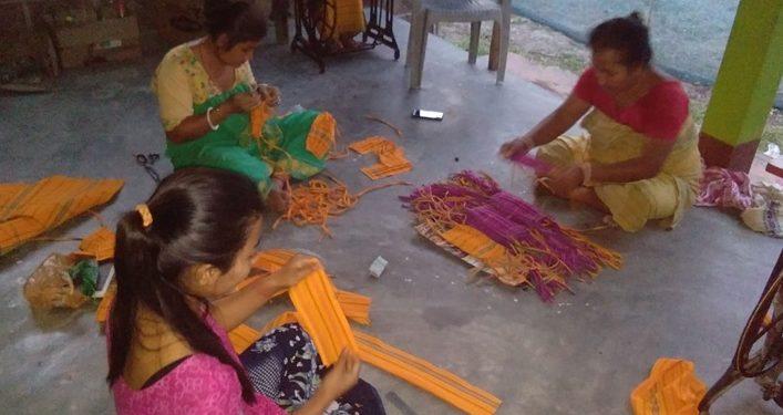 Members of SHG in Manas sewing masks at facility centres. Handout image
