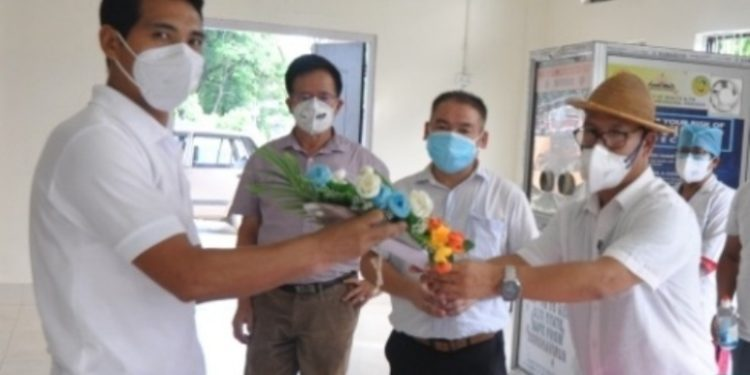 West Siang ADC Liyi Bagra handed over the discharge certificate to the recovered patient.