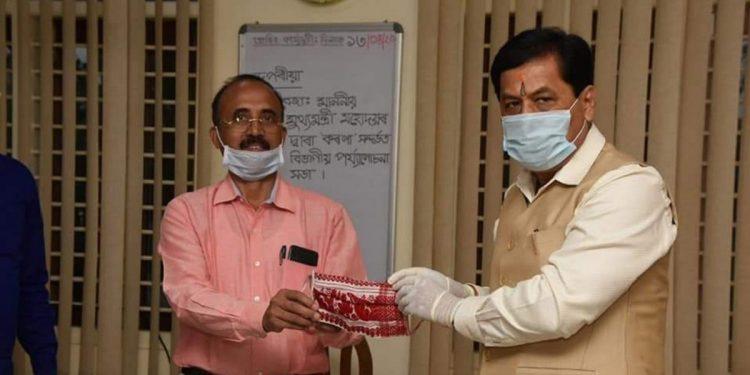 COVID-19 positive MLA Narayan Deka with Assam CM Sarbananda Sonowal