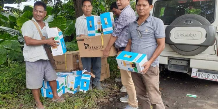 Forest department officials with relief materials. Image: Northeast Now