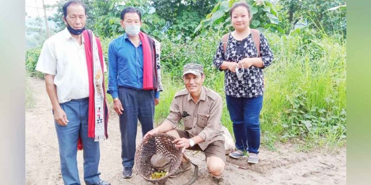 Range Forest Officer, I Sashilemla with village council members and staff before releasing the Slow Loris into Yimlu Forest Reserve.