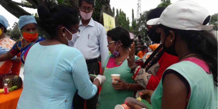 BJP Mahila Morcha members distributing Vitamin C enriched fruit in Tripura. Image: Northeast Now
