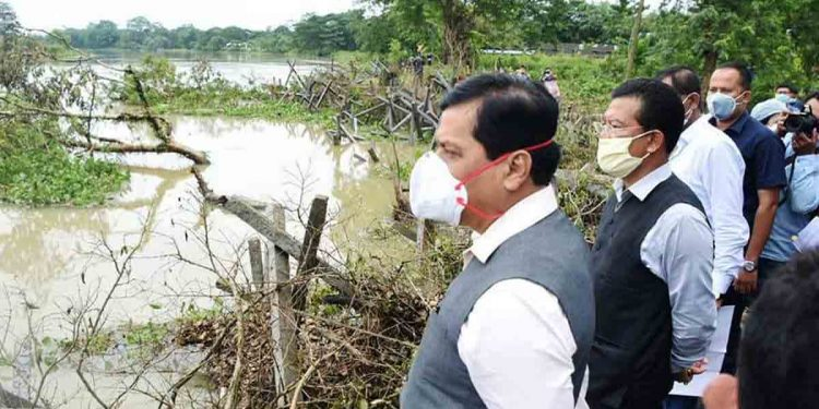 Assam CM Sarbananda Sonowal taking stock of the flood-hit areas of Lakhimpur