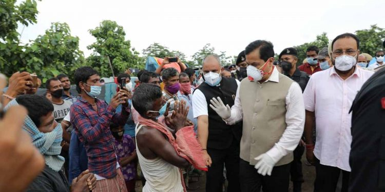 Assam CM Sarbananda Sonowal interacting with the flood-hit people in Morigaon on Sunday