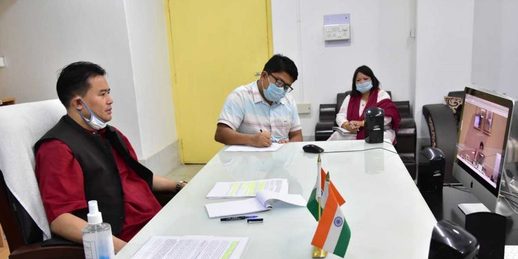 Manipur textiles minister Thongam Biswajit Singh during a video conference with Piyush Goyal. Image: Northeast Now