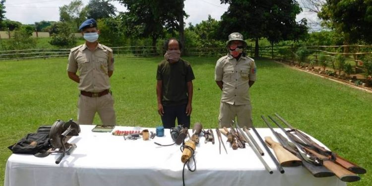 The alleged arms dealer in police custody.