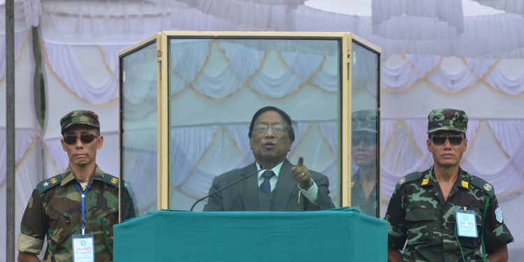 Th Muivah, general secretary of NSCN-IM addressing from a bullet-proof enclosure during the 69th Naga Independence Day celebration at Camp Hebron, some 40 km away from Dimapur, Nagaland on August 14, 2015. File Photo by Caisii Mao