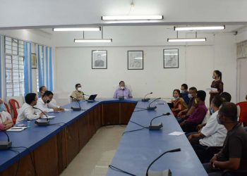 Dima Hasao DC with puja committee members. Image: Northeast Now