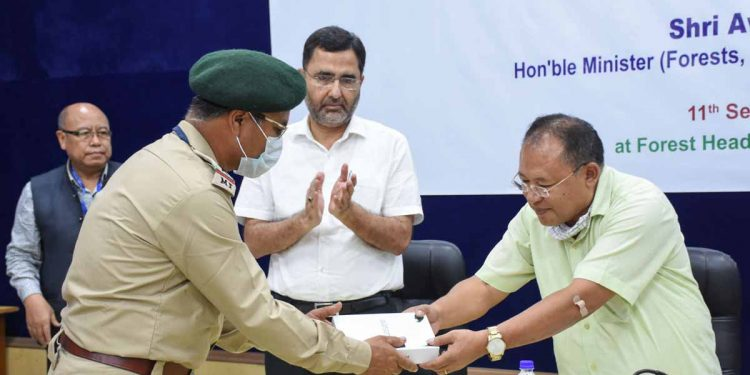 Manipur forest miniater Awangbow Newmai distributing Tablets to forest officials