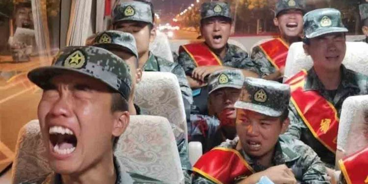 PLA soldiers crying on a bus. Image credit: Taiwan News