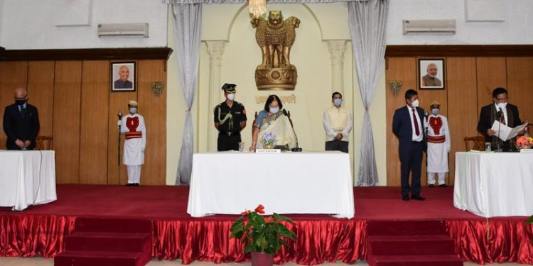 Governor Najma Heptulla administered oath of office and secrecy to the five ministers in a swearing ceremony at the Banquet hall of Raj Bhavan in Imphal.