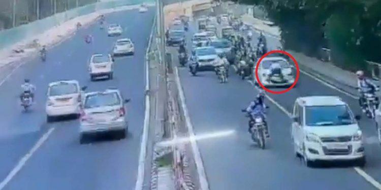 Traffic cop dragged on car bonnet