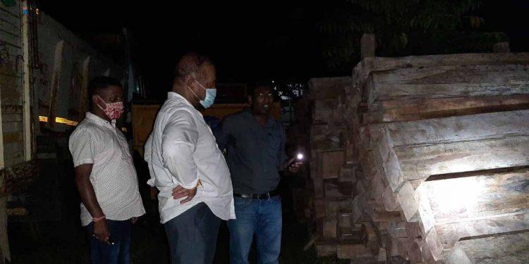 Assam forest minister Parimal Suklabaidya inspecting the seized timber
