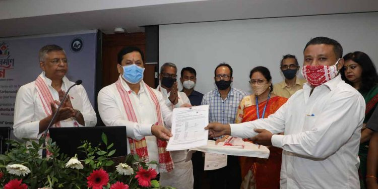Assam CM Sarbananda Sonowal handing over an instant permission for constructing house and no-objection certificate for selling plot to the beneficiaries