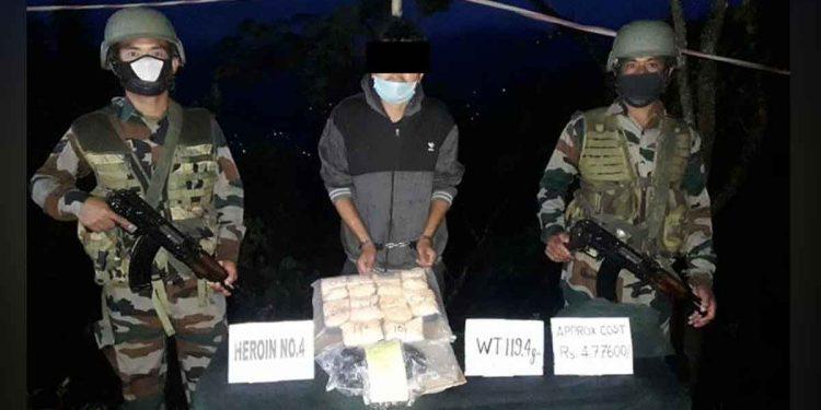 The arrested drug peddler with Assam Rifles team. Image: Twitter.