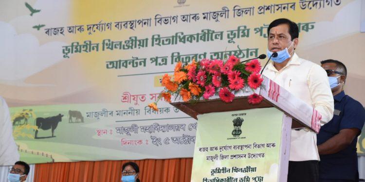 Assam CM Sarbananda Sonowal speaking at a programme in Majuli aftr distributing land pattas