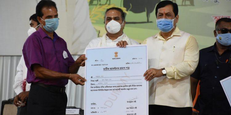 Assam CM Sarbananda Sonowal distributing land pattas to landless inigenous people in Mjuli