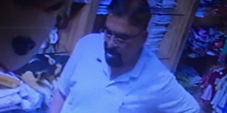 The officer, clad in white shirt and blue jeans, was caught on CCTV cameras stealing the mobile phone from the shop.