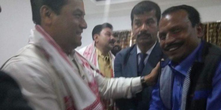 Arrested Debraj Das with CM Sarbananda Sonowal.