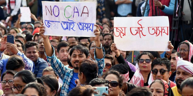 Assam, Dec 15 (ANI): People from various walks of life take part in a protest organized by artists from Assam demanding to scrap Citizenship (Amendment ) Act, at AEI Playground, Chandmari in Guwahati on Sunday. (ANI Photo)