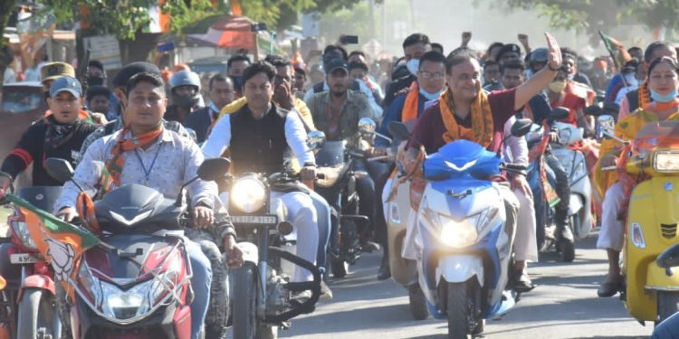 Assam finance minister Himanta Biswa Sarma was seen riding a scooter sans helmets during a bike rally at Bhairabkunda.