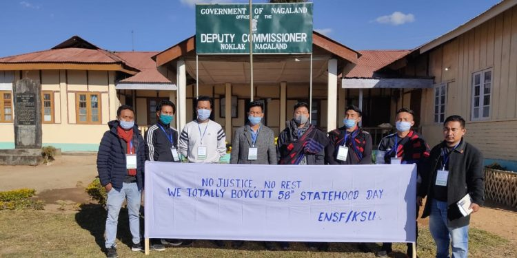 Members of Eastern Naga Students Federation protest in front of Noklak Deputy Commissioner's office on Tuesday.