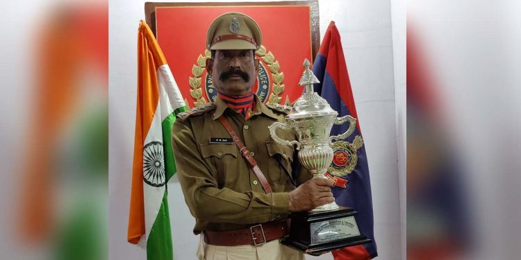 Inspector KM Das with the trophy. Image credit - Northeast Now