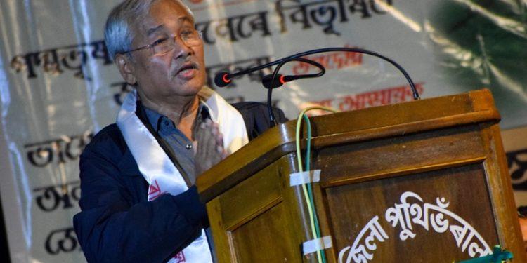 Filmmaker and party adviser Jahnu Baruah speaks at the meeting.