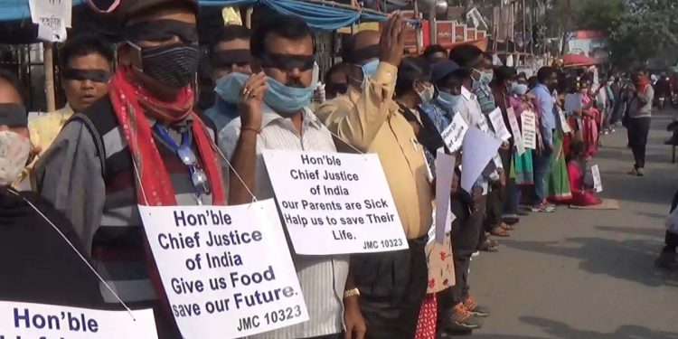 Tripura's terminated teachers stage protest by wearing black cloths on their eyes. Image credit - Northeast Now