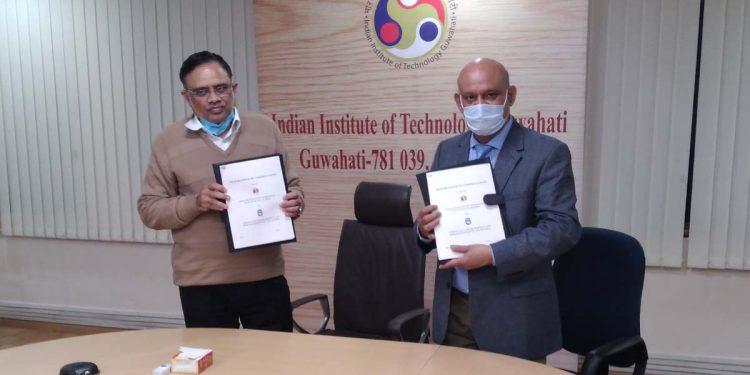 Prof TG Sitharam Director IITG signing MOU with Dr. Munidra Narayan Baruah