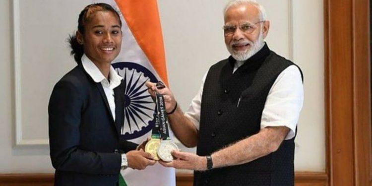 Hima Das with Prime Minister Narendra Modi (File photo)