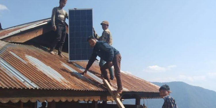 Solar light system being installed in a house at Shinnyu village in Mon district.